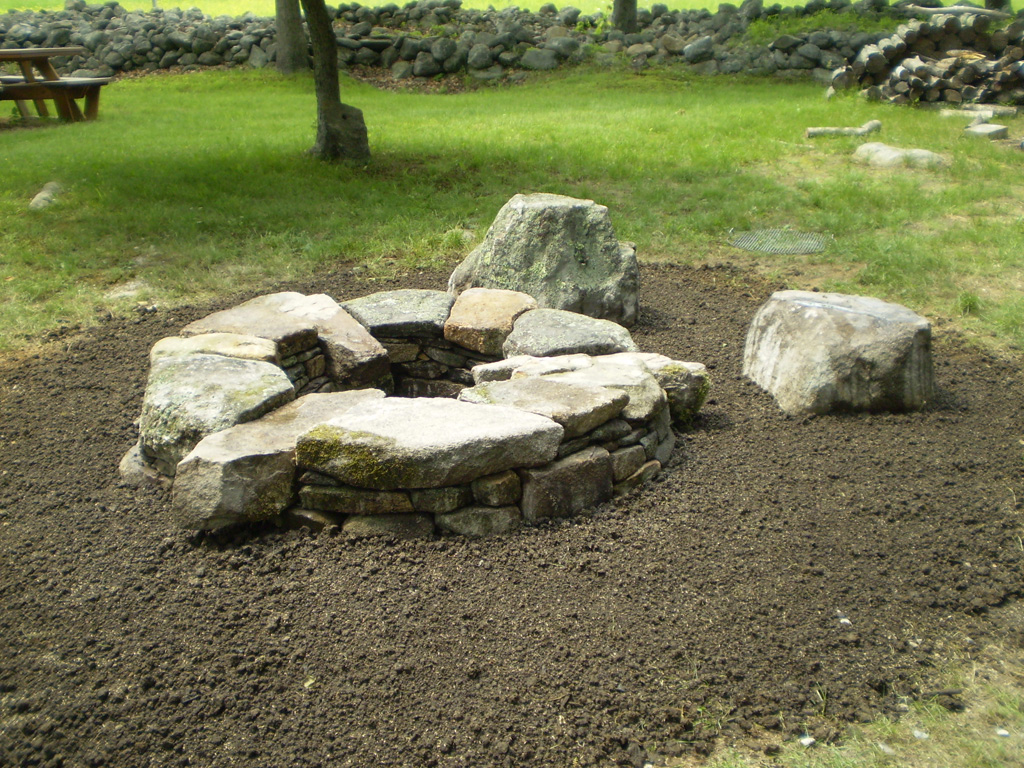 Stone fire pit casual cottage for How to build a fire ring with rocks